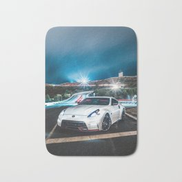 white 370z nismo parked with light streaks Bath Mat