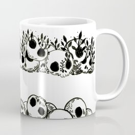 several piles of skulls Coffee Mug