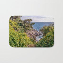 Yellow flowers on the seacoast of Cap Martin in a sunny winter day Bath Mat