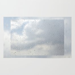 Raindrops flowing down on window glass Rug