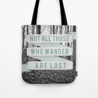 not all those who wander are lost Tote Bags featuring Not All Those Who Wander Are Lost by Sanguine Eyes