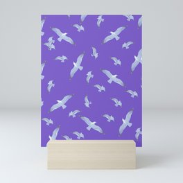 purple seagull day flight Mini Art Print