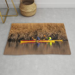 Two rowers sail on the river Rug