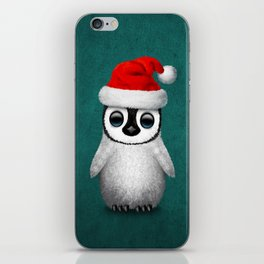 Baby Penguin Wearing a Santa Hat on Blue iPhone Skin