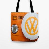 volkswagen Tote Bags featuring Volkswagen Orange by Alice Gosling