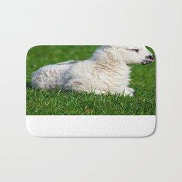 A Sleepy Newborn Lamb In A Field Bath Mat