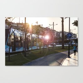 Tram running between the street and the walking path in Izmir Canvas Print