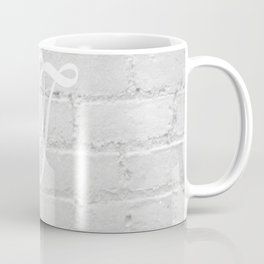 Edwardian T against white brick wall Coffee Mug