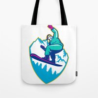 snowboard Tote Bags featuring Snowboarder Holding Snowboard Alps Retro by patrimonio