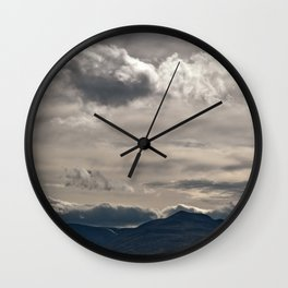 Clouds rolling over Wall Clock