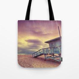Lifeguard tower at sunset at Hermosa Beach, California Tote Bag