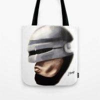 robocop Tote Bags featuring Robocop. by Jamie Briggs