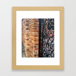 iron fence brick wall Framed Art Print