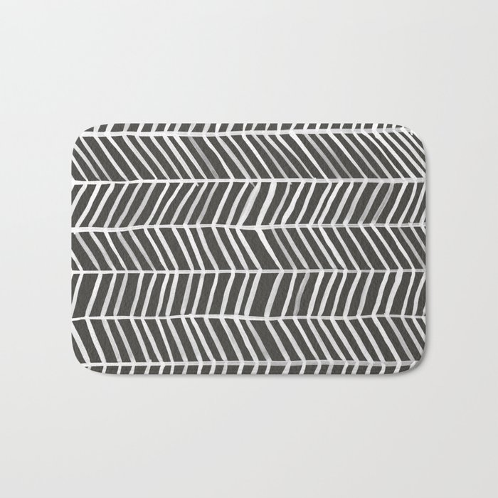 Herringbone black white bath mat by catcoq society6 for Black and white bathroom mats