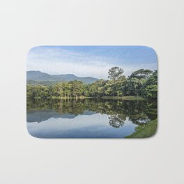 Idyllic scenic landscape of Ang Kaew Reservoir lake, surrounded by trees and mountains. Bath Mat