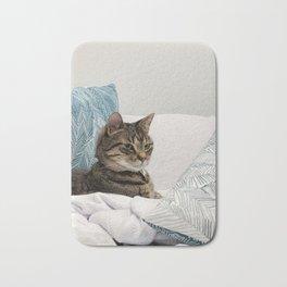 Tabby among pillows Bath Mat