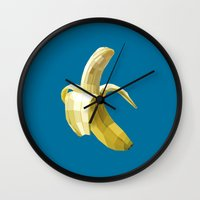 banana leaf Wall Clocks featuring Banana by Liam Brazier