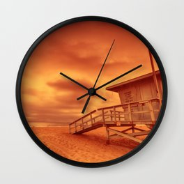 Lifeguard tower with the rosy afterglow of a sunset at Hermosa Beach, California Wall Clock