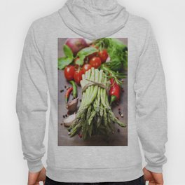 Fresh green asparagus bunch and vegetables on wooden board Hoody