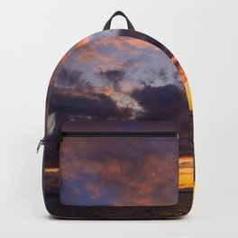 Glowing of clouds in the sky at sunset Backpack