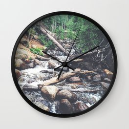 trees crashed in powerful river Wall Clock