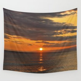 Sunset over the ocean with red sky Wall Tapestry