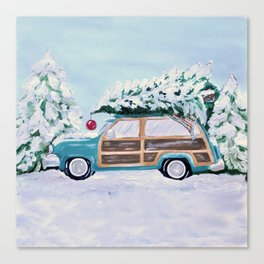 Blue vintage Christmas woody car with pine tree Canvas Print