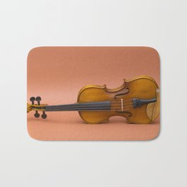 violin on a brown background Bath Mat