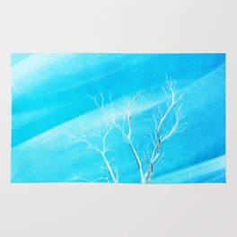Big white leafless tree blue background Rug