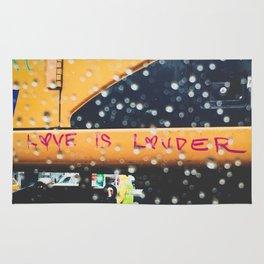 Graffiti seen through raindrops Rug