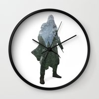 assassins creed Wall Clocks featuring Assassins Creed - Woodland 2 by Fatih