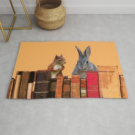 Rabbit with squirrel behind old Books #society6 Rug