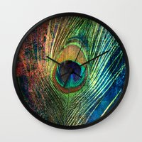 peacock feather Wall Clocks featuring peacock feather by mark ashkenazi
