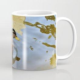Duck swimming in a golden lake Coffee Mug