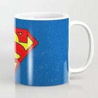 superman Mugs featuring Superman by Alisa Galitsyna