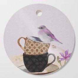 Bird in tea cup Cutting Board