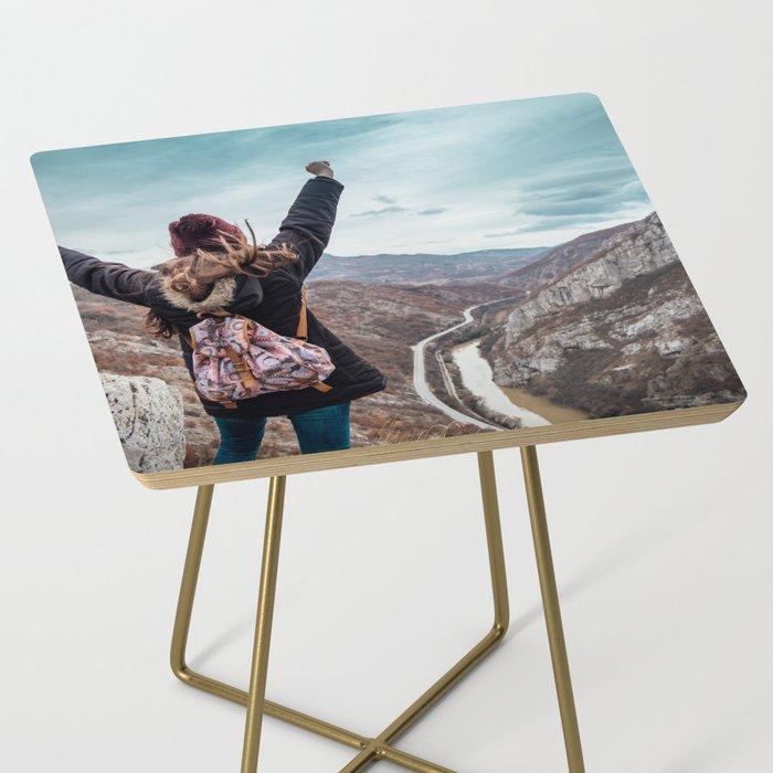 Tourist on the peak of high rocks. Big canyon on Balkan peninsula Side Table