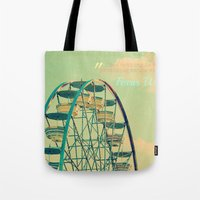 ferris wheel Tote Bags featuring Ferris Wheel  by RDelean