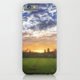 Greenfield under the cloudy sky at sunset iPhone Case