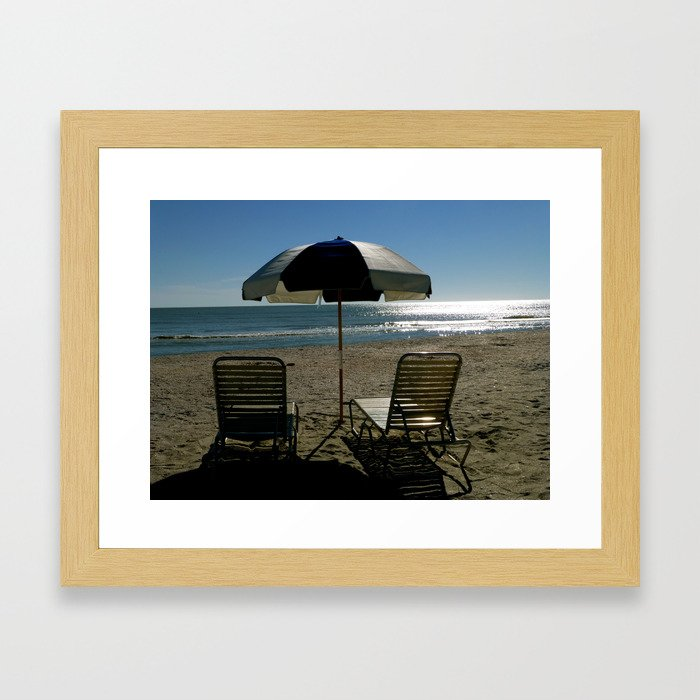 2 Chairs By The Sea.. Framed Art Print