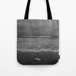 A lonely sea shell in the surf of Assateague Island (black and white) Tote Bag