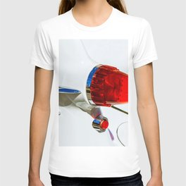 Red taillight of a white luxury car T-shirt