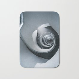 Spiral staircase in grey and blue tones Bath Mat