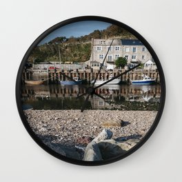 Boats moored in the harbour at Seaton. Devon, UK. Wall Clock