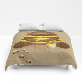 Milk chocolate bear imitating a bee on caramel background Comforters