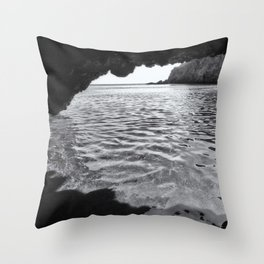 A B&W photo looks from the inside of a sea cave to the far horizon Throw Pillow