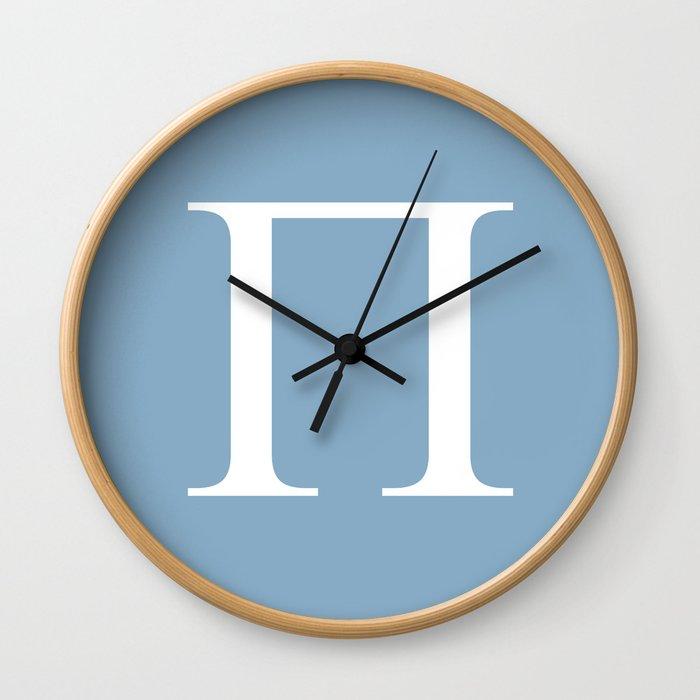 Greek letter Pi sign on placid blue background Wall Clock