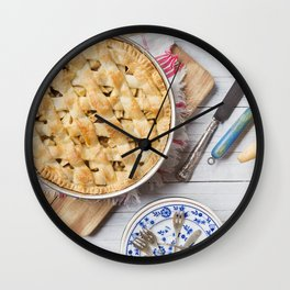 Homemade apple pie and ingredients on a rustic table Wall Clock