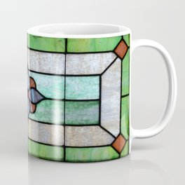 Stained Glass features a picture of a classic stained glass window typically found above a door Coffee Mug
