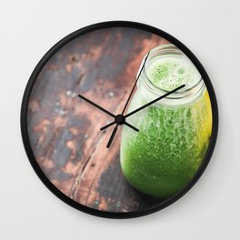 Close-up of green fresh smoothie with fruits, berries, oats and seeds, selective focus. Wall Clock
